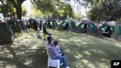 FILE: Members of the public wait to be tested for HIV and AIDS in Harare, Zimbabwe, June, 22, 2012.