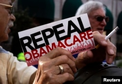 FILE - Demonstrators denouncing Obamacare during a protest in Indianapolis, Indiana, Aug. 26, 2013.