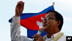 In this file photo taken on Dec. 22, 2013, Cambodian opposition leader Sam Rainsy of the Cambodia National Rescue Party delivers a speech before his party supporters during a rally in Phnom Penh, Cambodia.
