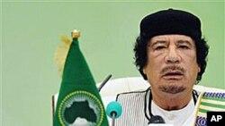 Libyan leader Moammar Gadhafi talks during the first session of the 3rd Africa-EU Summit in Tripoli, Libya, 29 Nov 2010.
