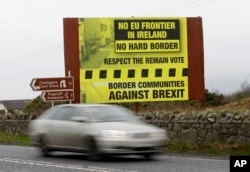 FILE - A car crosses over the border from the Irish Republic into Northern Ireland near the town of Jonesborough, Northern Ireland, Jan. 30, 2017. After Britain leaves the EU in 2019, the 500-kilometer (310-mile) border between Northern Ireland and Ireland will be the U.K.'s only land frontier with a member of the bloc.