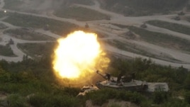 A South Korean army K1A1 tank fires during South Korea-U.S. joint military live-fire drills at Seungjin Fire Training Field in Pocheon, near the border with North Korea, June 22, 2012.