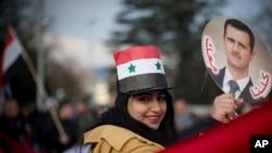 Shveysariyada Bashar al-Assad tarafdorlari namoyishi.