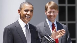 President Barack Obama (L) and nominee to serve as the first director of the Consumer Financial Protection Bureau (CFPB), former Ohio Attorney General Richard Cordray,  in the Rose Garden of the White House, Jul 18, 2011.