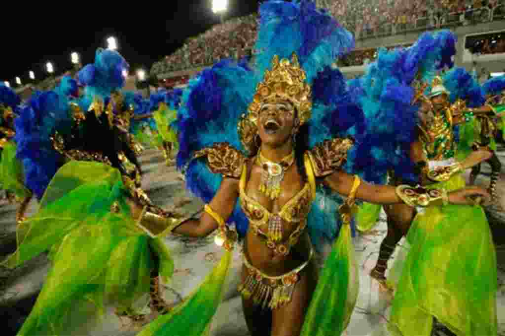 A dancer performs with 'Portela' samba school during carnival in Rio de Janeiro on early Tuesday, Feb. 20, 2007. (AP Photo/Jorge Saenz)