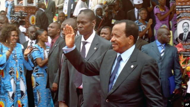 Cameroon's President Paul Biya waves to supporters during the opening of his party conference, in Yaounde, on September 15, 2011.