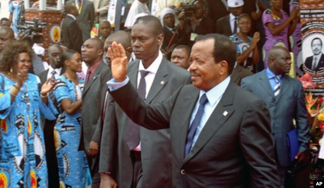 FILE - Cameroon's President Paul Biya waves to supporters during the opening of his party conference, in Yaounde, Sept. 15, 2011.