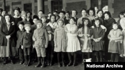 FILE - Immigrant children are part of this group photographed at Ellis Island in New York, about 1908.