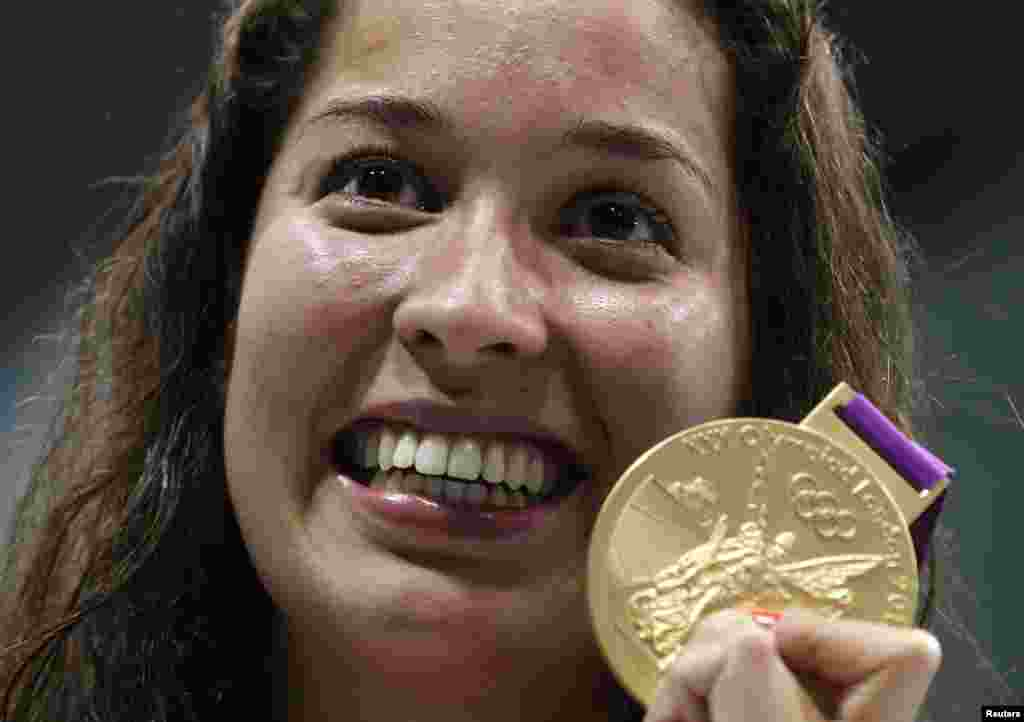 Ranomi Kromowidjojo of the Netherlands holds her gold medal during the women's 100m freestyle victory ceremony at the London 2012 Olympic Games at the Aquatics Centre August 2, 2012.