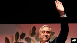 Newly-elected Turkish Cypriot leader Mustafa Akinci waves to supporters in Nicosia April 26, 2015.