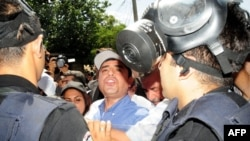 Peace and Democracy Party (BDP) leader Selahattin Demirtas (C) argues with Turkish riot policemen on July 14, 2012, in Diyarbakir.