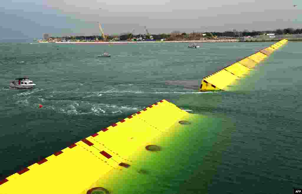 Gates emerge from the water during tests of an experimental project intended to protect Venice from floods.