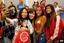 Rep. Jacky Rosen, D-Nev., center, poses for a selfie with high school students at an event put on by the Asian Community Development Council in Las Vegas, Sept. 29, 2018. In the high-stakes race for Senate in Nevada, Rosen is taking on one of the biggest names in GOP politics by painting Sen. Dean Heller as someone without firm principles.