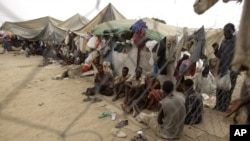 FILE - Ethiopian migrants are seen in a make-shift camp near the western Yemeni town of Haradh in a March 21, 2012, photo.