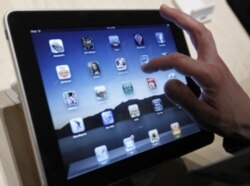An iPad with many choices of apps