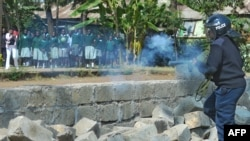 Police tear gas children from the Langata Road Primary School during a protest over a land dispute Jan. 19, 2015 in Nairobi.