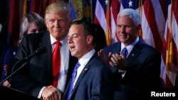U.S. President elect Donald Trump shakes hands with Republican National Committee Chairman Reince Priebus (C) as Vice President-elect Mike Pence (R) looks onat election night rally in Manhattan, New York, Nov. 9, 2016.