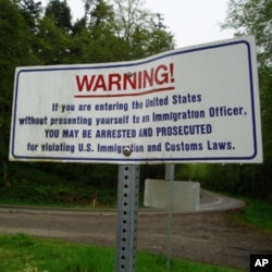 Warning signs like this one are posted along the US-Canada border.