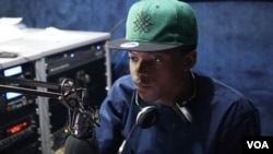 Kaduna-native Jakes Tudu hosts a weekly radio show to promote local rappers. (C. Oduah/VOA)