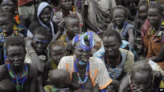 Victims of ethnic violence in Jonglei, state, South Sudan, wait in line at the World Food Program distribution center in Pibor, South Sudan to receive emergency food rations, January12, 2012.