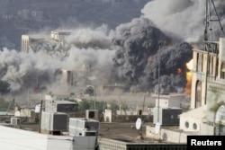 FILE - Smoke billows during an airstrike on the Republican Palace in Yemen's southwestern city of Taiz, April 17, 2015.