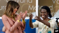 Godelieve Mukasarasi of Rwanda, holds up her award presented by first lady Melania Trump at the 2018 International Women of Courage awards, March 23, 2018, at the State Department in Washington. Mukasarasi helped the first criminal prosecution of rape as