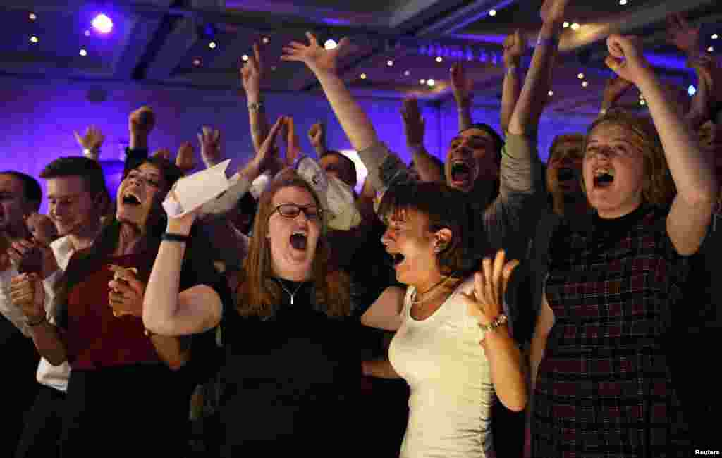 "Supporters from the ""No"" Campaign react to a declaration in their favor, at the Better Together Campaign headquarters in Glasgow, Scotland. Scotland voted on Thursday on whether to stay within the United Kingdom or end the 307-year-old union."