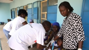 Health workers take a blood sample from a child in Gusau, northern Nigeria.