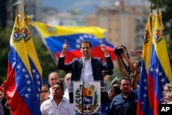 FILE - Juan Guaido, head of Venezuela's opposition-run congress, declares himself interim president of the nation until elections can be held during a rally demanding President Nicolas Maduro's resignation in Caracas, Venezuela, Jan. 23, 2019.
