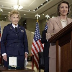 Deanie Parrish listens to comments by House Speaker Nancy Pelosi during a Congressional Gold Medal presentation ceremony in Washington earlier this year