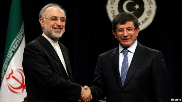 FILE - Turkey's Foreign Minister Ahmet Davutoglu and Iranian counterpart Ali Akbar Salehi, left, at news conference, Ankara, Jan. 19, 2012.