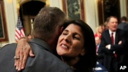 U.S. Ambassador to the United Nations Nikki Haley hugs Department of the Interior Secretary Ryan Zinke, as she arrives for the Interagency Task Force to Monitor and Combat Trafficking in Persons meeting in Washington, Oct. 11, 2018.