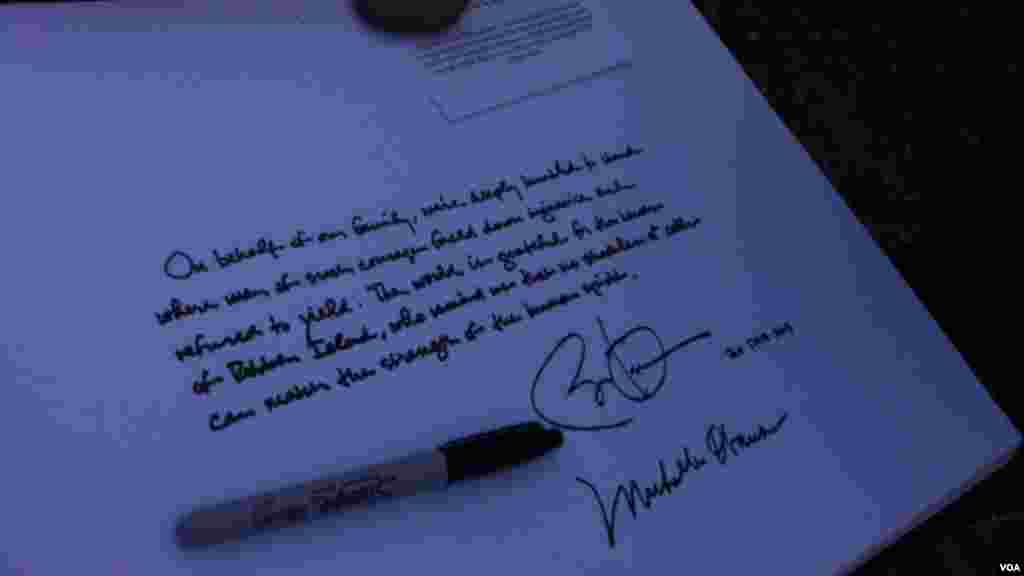 President Obama signing guest book at Robben Island prison in South Africa.