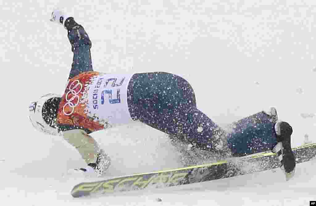 Japan's Taihei Kato breaks his left arm as he falls during the Nordic combined individual Gundersen large hill competition at the 2014 Winter Olympics, Feb. 18, 2014.