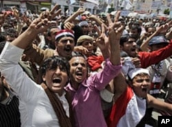 Anti-government protesters shout slogans during a demonstration demanding the resignation of Yemeni President Ali Abdullah Saleh, in Sana'a, May 7, 2011