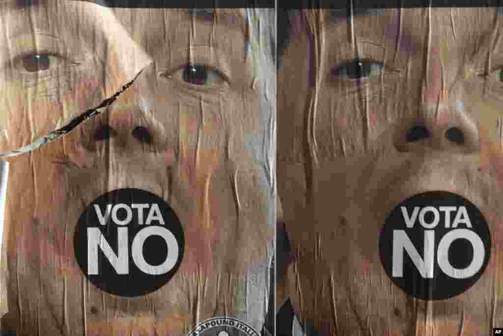 Anti-referendum posters showing Premier Matteo Renzi are seen in Rome, Italy, a day after the referendum vote. Voters rejected his proposed constitutional reforms, plunging Europe's fourth-largest economy into political and economic uncertainty.