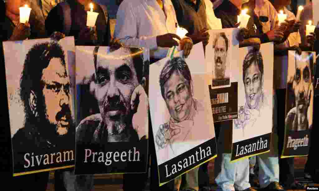 "Media members from Sri Lanka hold signs of reporters at the ""Black January"" vigil to remember what organizers said are the killings and abductions of journalists who have disappeared during the month of January in past years, in Colombo."