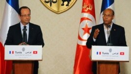 Tunisian President Moncef Marzouki , right, addresses reporters during a joint press conference with French President Francois Hollande, left, Carthage, Tunisia, July 4, 2013.