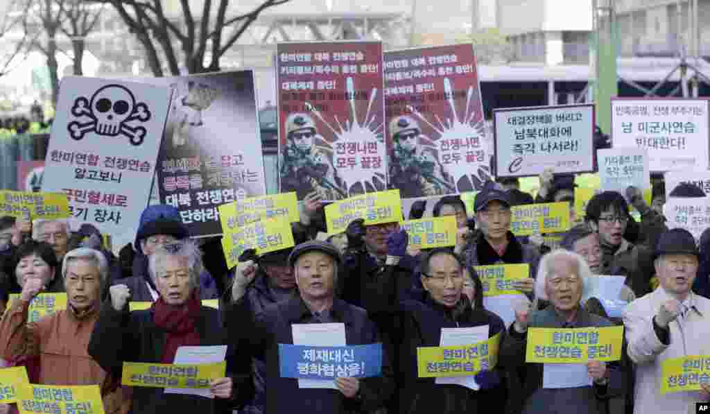 South Korean protesters shout slogans during a rally denouncing the annual joint military exercises between South Korea and the United States, near the U.S. Embassy in Seoul, South Korea, March 11, 2013.