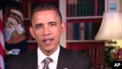 US President Barack Obama delivers his weekly address, 21 May 2011.