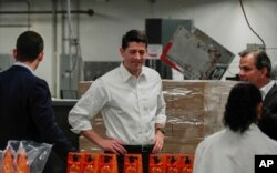 House Speaker Paul Ryan (C) tours a packaging facility in West Albany, Ohio, May 10, 2017.