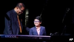 The jazz world has a new great musician. Joey Alexander is pictured here with legendary Herbie Hancock at the Apollo Theater, New York City, October 2014. Joey, by the way, is the child. (AP PHOTO)