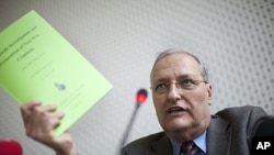Efraim Zuroff, Chief Nazi hunter of the Simon Wiesenthal Center and director of the Center's Jerusalem Office, gestures during a news conference in Berlin, Germany, December 14, 2011.