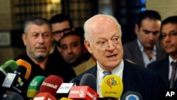 In this photo released by the Syrian official news agency SANA, United Nations special envoy to Syria Staffan de Mistura, speaks during a press conference in Damascus, Syria, Tuesday, Nov. 11, 2014.