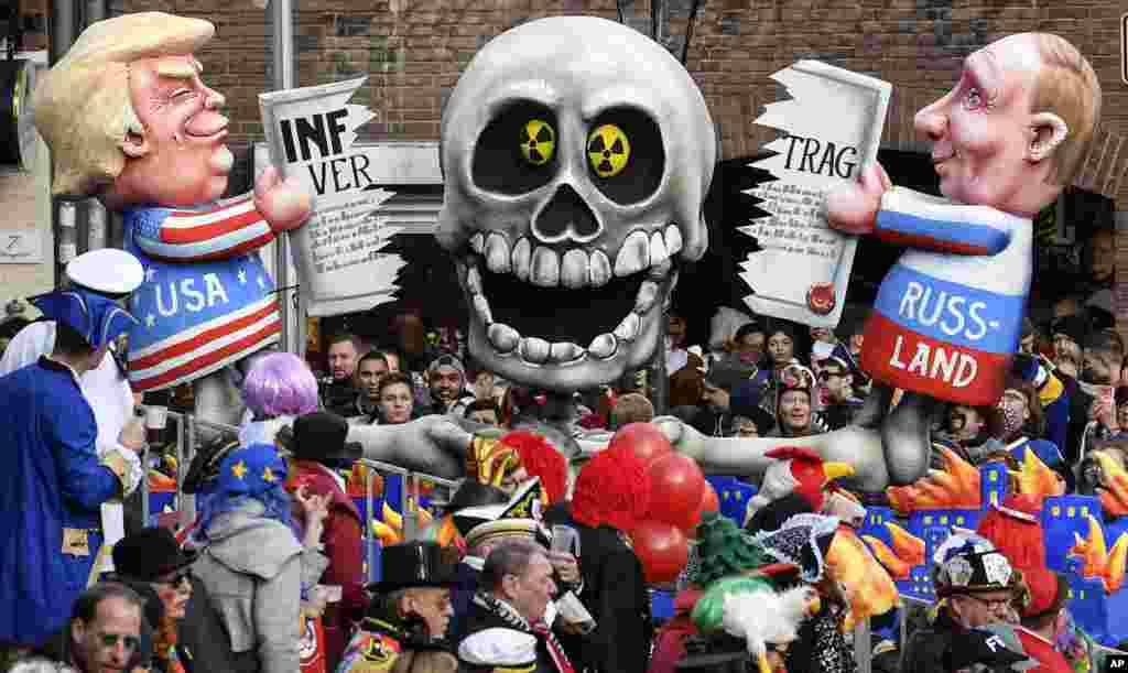 A carnival float representing Donald Trump and Vladimir Putin cutting the INF (Intermediate-Range Nuclear Forces) Treaty is seen during to the traditional carnival parade in Duesseldorf, Germany.
