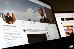 A Twitter page of Chinese exiles businessman Guo Wengui is seen on a computer screen in Beijing. Escalating efforts to repatriate one of its most wanted exiles, China's ruling Communist Party has opened a police investigation on a new allegation, rape, against Guo.