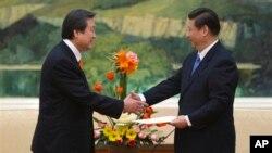중국의 시진핑 국가주석(오른쪽)이 지난 1월 부주석 당시, 한국 박근혜 대통령 특사로 베이징을 방문한 김무성 전 의원과 면담했다.