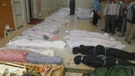 The bodies of people purportedly killed by Syrian government security forces are laid out in Houla near Homs, May 26, 2012.