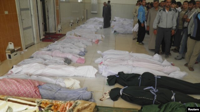 The bodies of people purportedly killed by Syrian government security forces are laid out in Houla near Homs May 26, 2012.