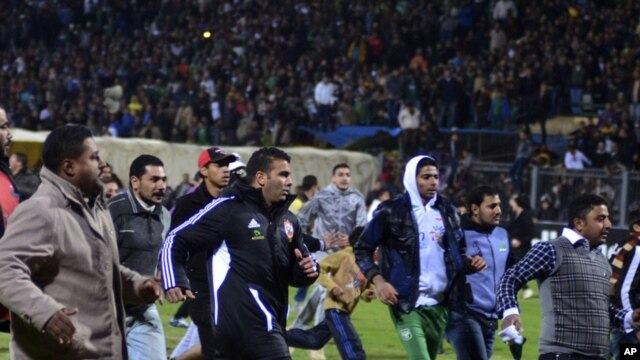 Football fans try to leave the stadium as chaos erupts at a soccer stadium in Port Said city, Egypt, February, 1, 2012. Seventy-three people were killed and at least 1,000 injured on Wednesday after a soccer pitch invasion in the Egyptian city of Port Sai